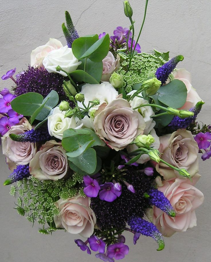 Hand-tied posy consisting of Veronica, Phlox, Trachlium, Eucalyptus, Roses, Dill, and Eustoma. Created by Floresta.co.uk