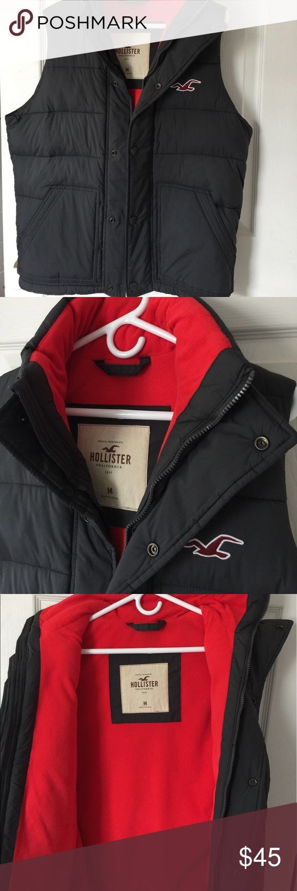 Men's Puffer Vest Hollister Warm Puffer Vest, rarely worn. Still in great condition. Bright red interior lining. Interior drawstring cord as well. No inside pocket, just 2 exterior pockets as shown. Color is very dark gray, almost like charcoal. Kept in a smoke/pet free household. Hollister Jackets & Coats Puffers