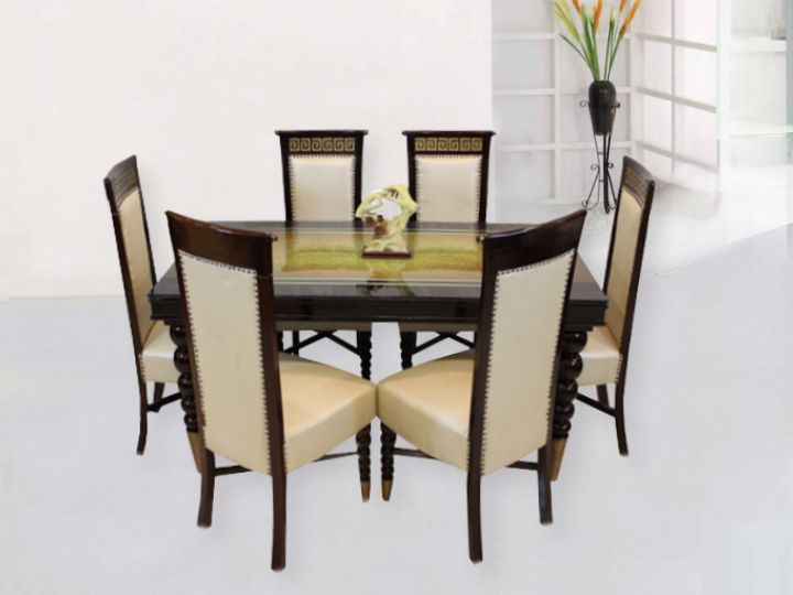 Create a classy effect at home with this six seater dining set. This comes in with Digital Glass Top while the chairs sport a mesmerizing layer of design. The legs of the table form a charming design. Nothing less than a beautiful and ethnic T-light will serve to complete the look of this magnificent dining set.