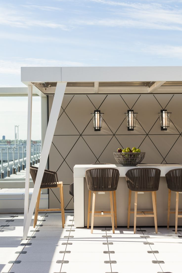 #ThomFilicia uses our Lu Sconces to lighten up Delta's Atlanta and JFK Skydesks!: