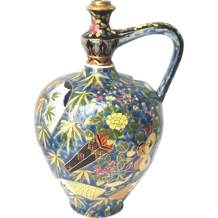 Large water jug made by Fischer Budapest The jug is heavily decorated with polychrome chinoiserie motifs on a blue ground and sports a delicately