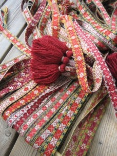 Bunch of red ribbons, 2010 by yarn jungle, via Flickr