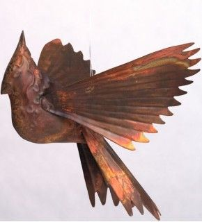 This handcrafted Cardinal Hanging Ornament makes a great garden accent or indoor decoration! Made from recycled metal with a flamed copper finish, this Cardinal gracefully sways in a gentle breeze. It's also available in a galvanized finish and a verdigris (green) copper finish!
