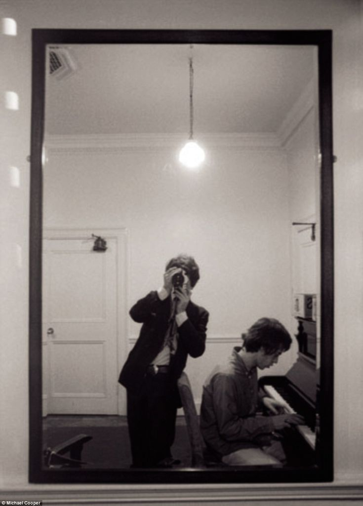Band of brothers: Rare photos capturing extraordinary bond between Mick Jagger and Keith Richards at height of Rolling Stones' Sixties fame to go on display. Michael Cooper takes a picture of Mick Jagger alone at the piano by shooting into the mirror - a shot that also obscures his face