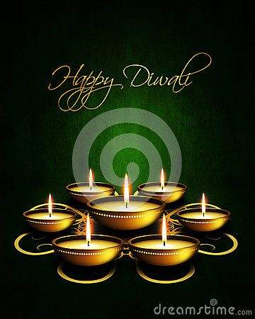 Oil lamp with diwali greetings over dark green background