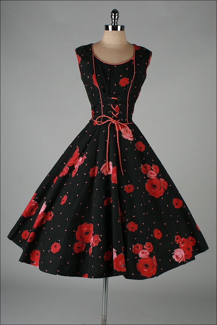 Vintage 1950's dress from Millstreet Vintage - black w/ Red Roses & polka dots. Corset-style in front ties.