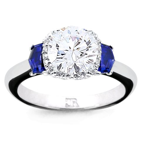 Twin fancy cut sapphires flank a very fine round brilliant, with pave set underbezel. Colour and Light. Exclusive to Charles Rose. Fully hand made in 18 carat