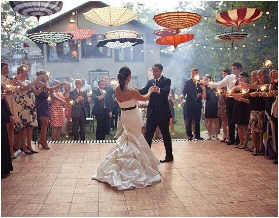 Circus themed wedding. Love those umbrellas! {photographer Gabriel Ryan}