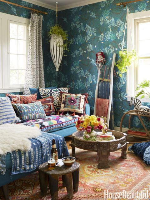 The Moroccan-inspired lounge, which Blakeney has dubbed Bluhemia, is wallpapered with Aja in Teal, one of her designs for Hygge & West. The sectional is from Jonathan Louis, and the faux sheepskin is from Target.