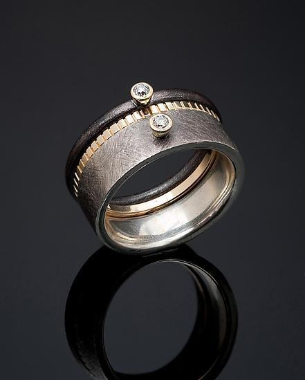 Rings |  Stephen Dixon.  Sterling silver, 18KY gold and diamond solitaire rings separated by a narrow 18KY notched band.