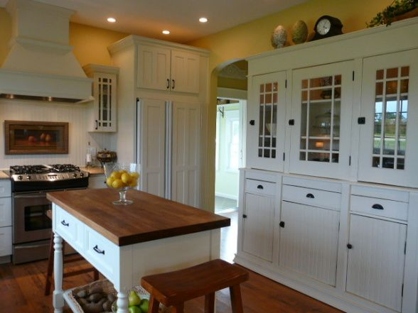 My MO farmhouse kitchen, Built in 2004. I had been wanting an old farmhouse to renovate but couldnt find what we were looking for so we decided to build new on an old dairy farm site. I tried to incorporate some old with the new to give us that aged feeling. I found the cabinet in a second hand shop and added paint mullions to the doors and painted the rusted hardware black. The micro and coffee maker are behind closed doors., Kitchens Design # 5th WaLL Like stove, flooring, builtins
