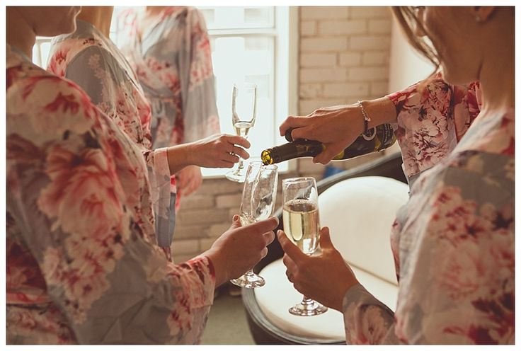 Champagne toast with bridesmaids, floral bridal robes - photo by New Vintage Media