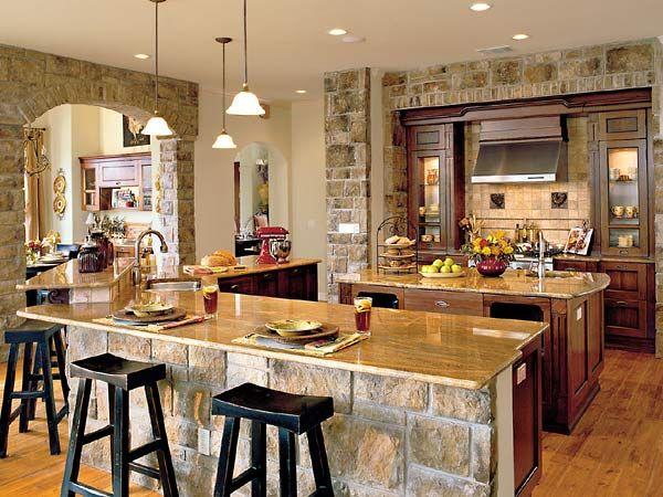 Maybe one of the best kitchen layouts I've seen. Open, lots of counter space and stone...nice. I'm going to pretend there is a pantry and lots of cabinets on that other wall