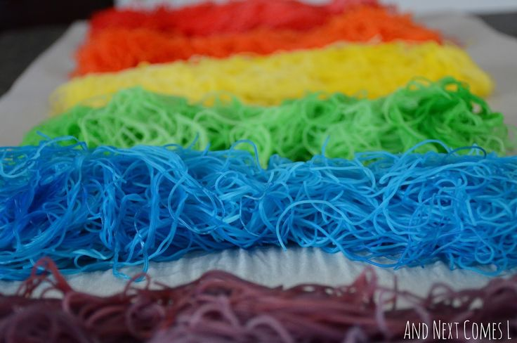 Close up of rainbow dyed rice noodles for sensory play from And Next Comes L