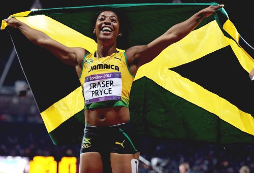 Shelly-Ann Fraser-Pryce celebrates winning the gold for Jamaica in the women's 100M. I always root for the Jamaicans in the sprints, can't help it....I just love their spirit & sass.