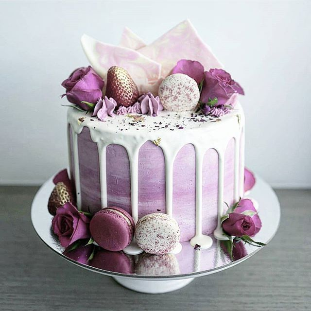 Pink heather & lilac hued rose, chocolate marble bark & macaron drip cake by Bake You Smile.