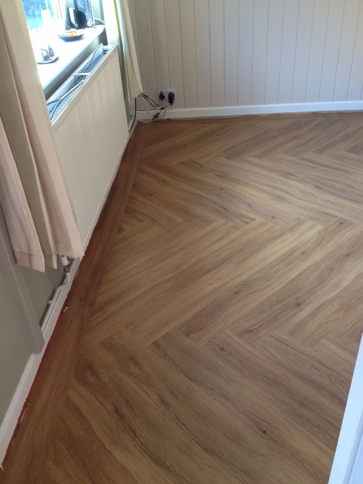 Polyflor Colonia Schoolhouse Oak - fitted in a herringbone pattern with a straight border
