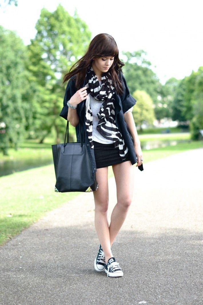 Black mini skirt, under loose white T-shirt &   short-sleeved button-down Shirt