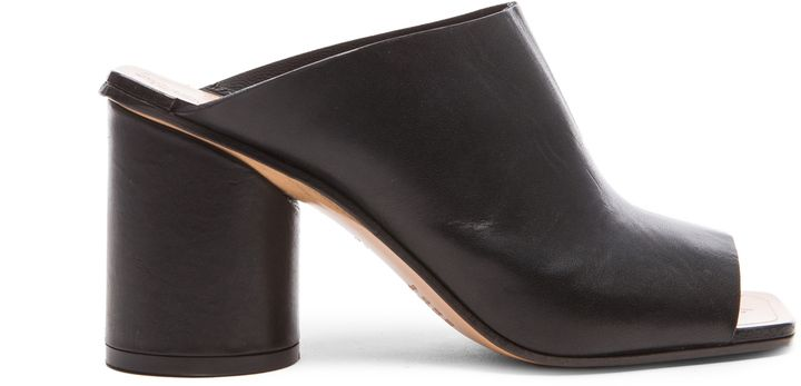 $427, Black Chunky Leather Mules: Maison Margiela Leather Mules. Sold by Forward By Elyse Walker.