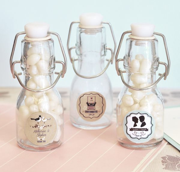 These vintage personalized mini glass bottle wedding favors are perfect for your shabby chic or rustic DIY affair.  These little bottles are great for packaging any number of items from small notes (like a message in a bottle) to liquids such as BBQ sauce, hot sauce, vanilla extract - to even packaging for candies and mints.  Bottles arrive separate from the labels. Some assembly required (attaching the self-stick labels to the bottles).