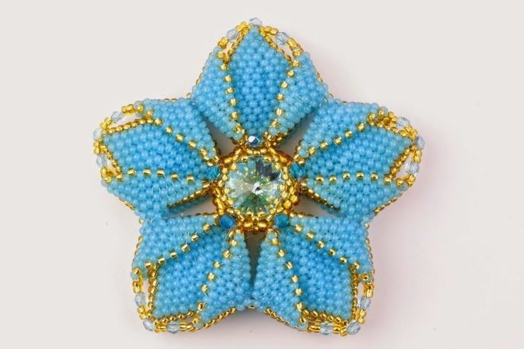 Masterclass instructions for an unusual bead woven flower. In Russian but excellent photos to show every step.