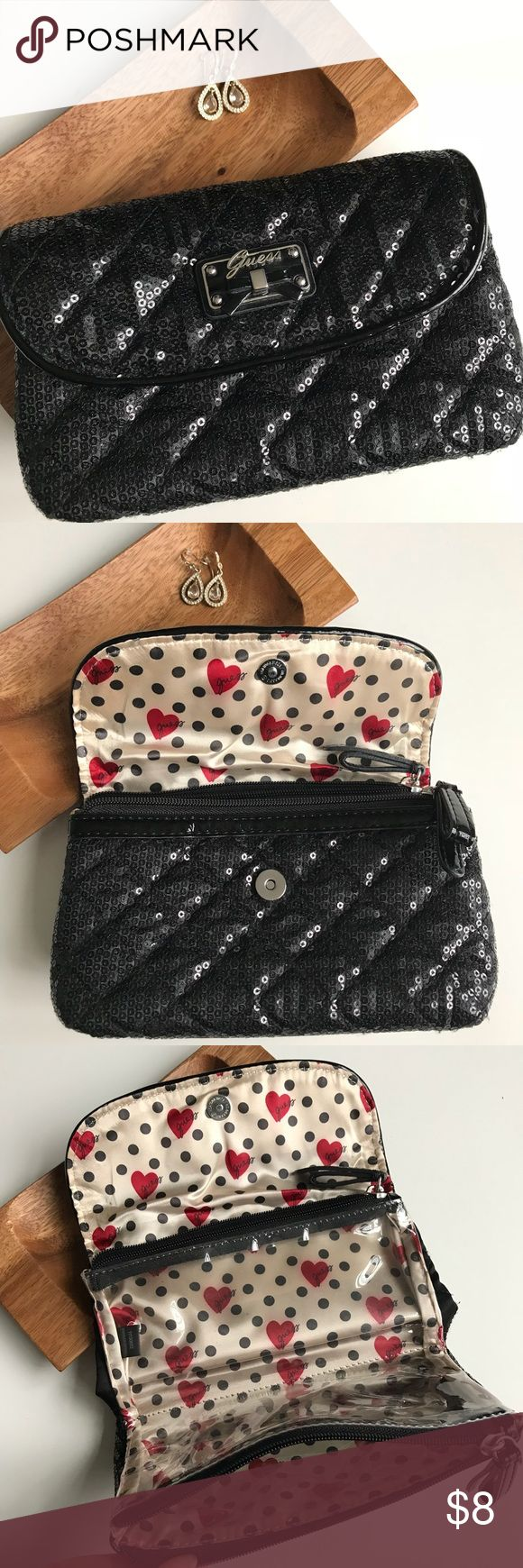 "🌿Guess Clutch Purse Black sequined Guess clutch with 2 clear, zippered,  interior pouches. Lined with fun fabric while the exterior is a cushioned quilted feel. Used twice, in excellent condition.   •8"" long.         • 4.25"" tall,   •2.75"" deep. Guess Bags Clutches & Wristlets"