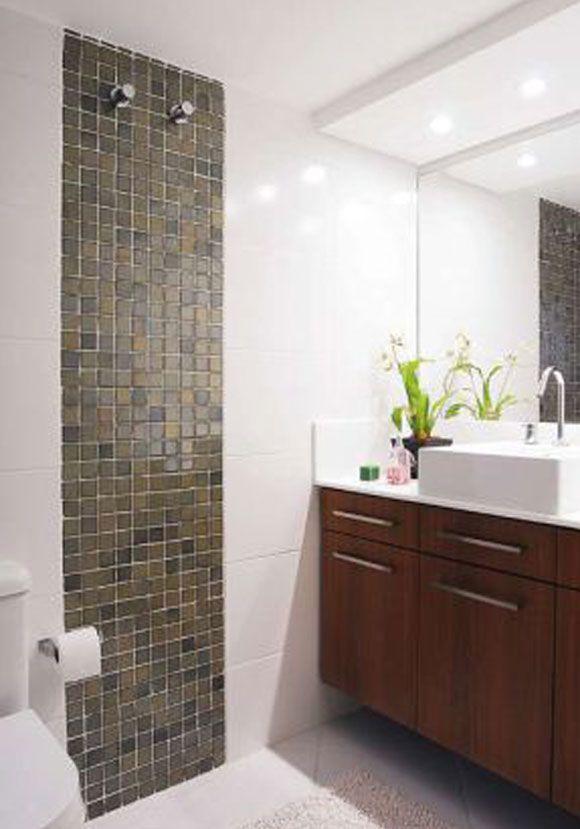 Com revestimento em cerâmica branca e discreta, esse banheiro é uma opção eco -> Banheiro Com Ceramica E Pastilha