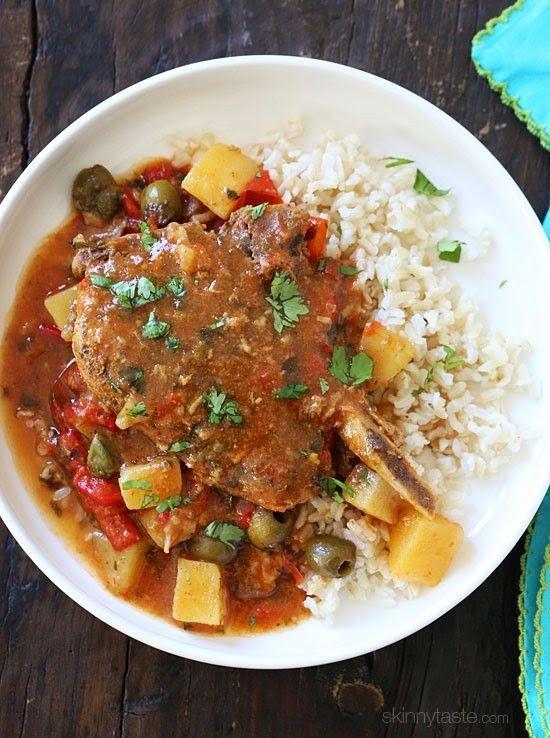 These pork chops are seasoned with Latin spices and slow cooked in a flavorful sauce with tomatoes, olives, peppers and potatoes. They literally fall of the bone when they come out of the slow cooker! I love to serve them with just a little brown rice on the side, but totally optional!