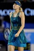JANUARY 2010 - Maria Sharapova sported a blue-green chiffon dress during her match against fellow Russian Maria Kirilenko.