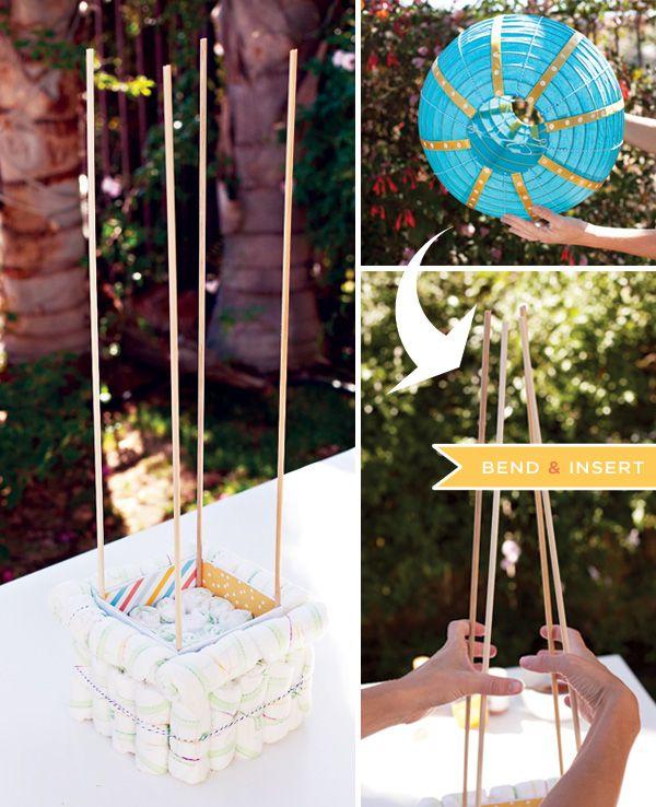 Tutorial de armar un globo aerostático con pañales y globo chino para baby showers. #DecoracionBabyShowers