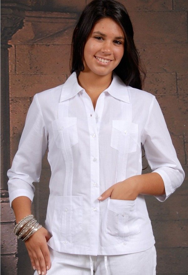 Uniform Polycotton Guayabera for Ladies. 3/4 Sleeve. White - Polycotton Guayabera for Ladies.  80 % Polyester 20 % Cotton. Uniform.  Easy care. Do not bleach. Wash and wear.  Available in White, L.Blue, Yellow and Black.  This guayabera Runs Small.  Availability is subject to change  Runs small. Call us for Uniform price.
