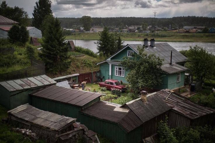 A local man works in the garden of his private house on the bank of Sukhona River, in the town of Totma, the administrative center of Totemsky District in Vologda Oblast, July 2015.