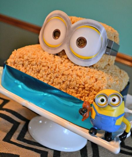 Simple Minions Marshmallow Crispie Bar Layer Cake tutorial. Such an easy idea to celebrate, or party, with our little yellow friends with a timeless recipe. #MinionsMovieNight ad