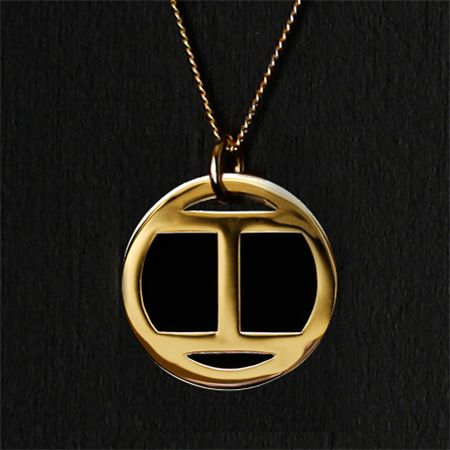 Gold Numerology pendant from Blackbird London. Calculate your life path number and pick from the elegant roman numeral pendants.