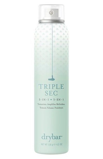 Drybar Triple Sec 3-in-1 Spray, which volumizes (1), texturizes (2), and works as a dry shampoo (3).