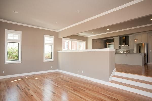 A new take on the Sunken Living Area. While open to the Kitchen area, the drop in elevation gives the room a separate feel while still being connected. This room is at the back of the home and opens out onto the deck.