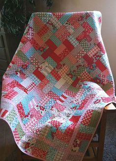 """Jolly Jelly Roll Quilt - quilt a long tutorial - all the steps laid out   51x51"""" quilt top using a jelly roll + 1yd solid for border/binding"""