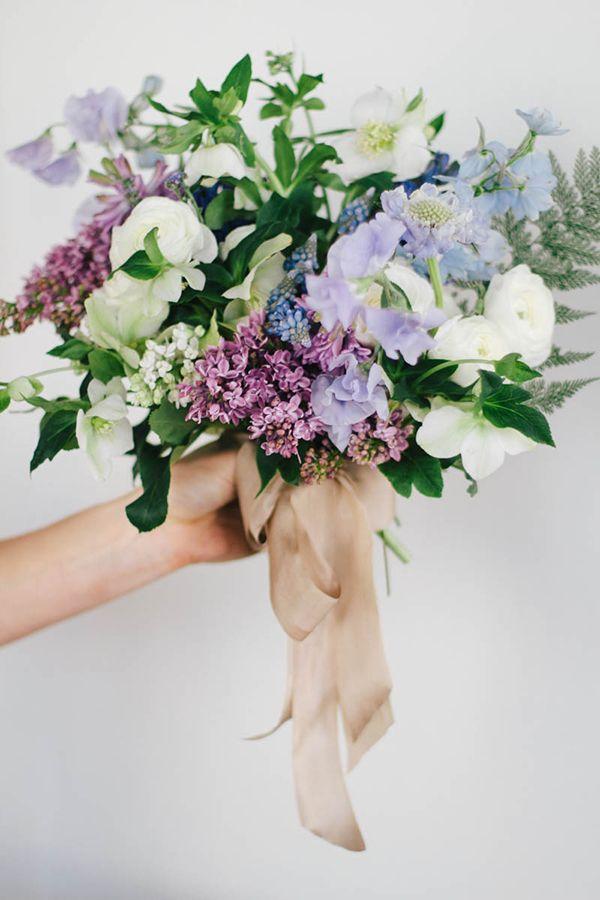 Hellebore, Hyacinth, Sweet Pea, Ranunculus, Fritillaria, Muscari, Scabiosa, Lilac, and Delphinium.  Blue Flowers | Spring Wedding Flowers from Sarah Winward / photos by Kate Osborne
