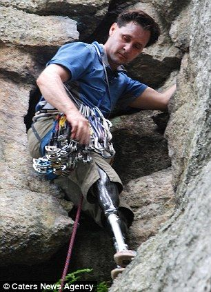 Hugh leans on the side of the cliff as he prepares to climb further up