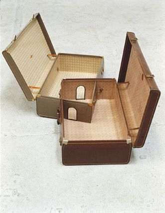 """Andrew Carnie,""""ONE PLUS ONE"""", Sculpture, CUT SUITCASE    Info Cut suitcase work from the late 1980's. Simple alterations were made to the suitcases to make works about travel, migration, and memory."""