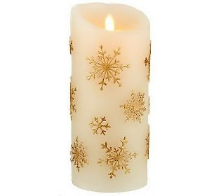 embossed snowflakes add gilded glamour to the beautiful believable flicker of this candle luminara candles