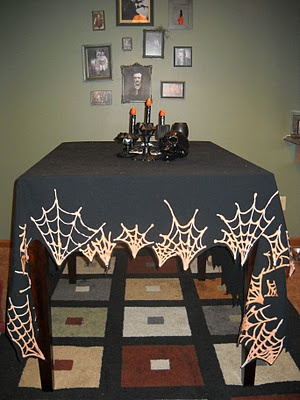 cool decor idea - DIY Bleach Pen drawn spider webs on black