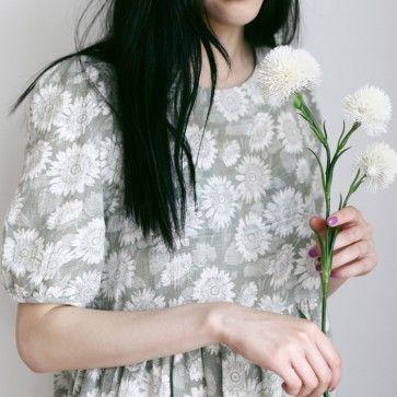[Khaki Sunflower Dress] A #dress featuring a floral print. Round neckline. Half sleeves. Back keyhole with button closure. Shirred skirt. #koreandress #cutedress #floraldress #flowerdress