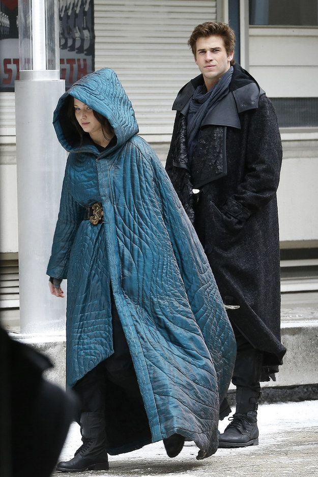 """First of all, Gale (Liam) and Katniss (Jennifer) are in large hooded cape snuggie things: 