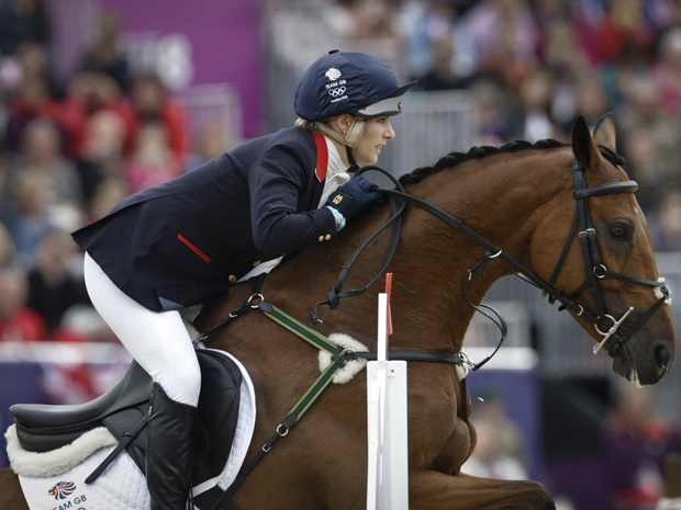 The queen's granddaughter Zara Phillips added to the family silver on Tuesday, helping team Britain to a second-place finish behind Germany in Olympic equestrian eventing. 2012