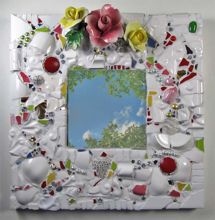 Snowy Spring mirror of antique china shards, flowers, and small shiny red accents.