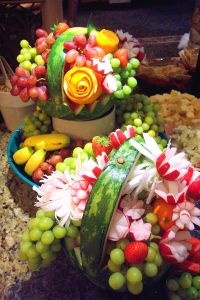 lovely carved and whole... fruit and veggie arrangement., whole new meaning to playing with your food ;)