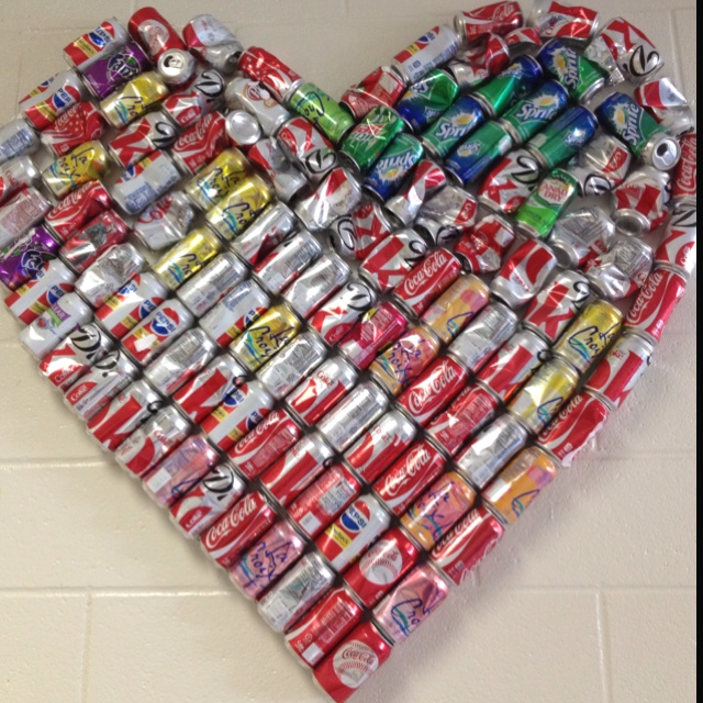 Recycled can wall art created by students.