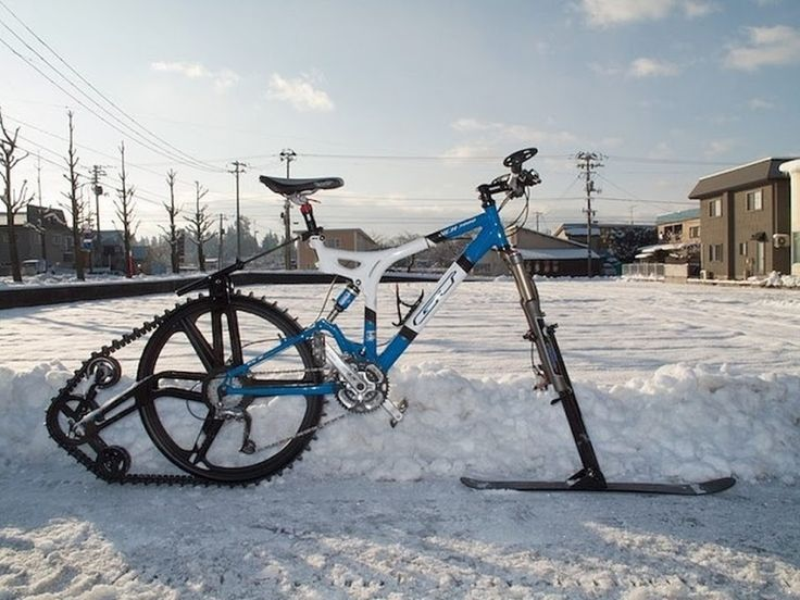 Ktrak - Patented wheel system that turns a mountain bike into a pedal-powered snow machine and all terrain vehicle. Created by Kyle Reeves, the biking innovation is a kit that can attach to the rear of any mountain bike. It creates traction on previously 'unridable' surfaces such as snow or sand, turning your bike into a snow or sand plough.