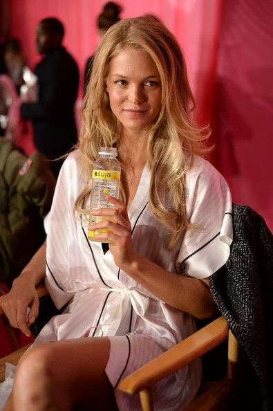 Model Erin Heatherton prepares at the 2013 Victoria's Secret Fashion Show hair and make-up room at Lexington Avenue Armory on November 13, 2...